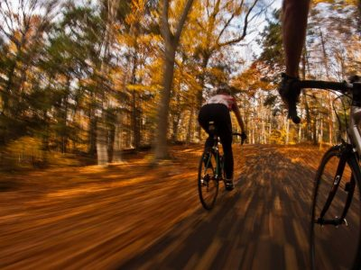 riding bikes through leaves in autumn
